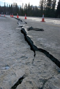 Photos by Jenny Neyman, Redoubt Reporter. A 150-foot section of Kalifornsky Beach Road near Kasilof was damaged in the magnitude 7.1 earthquake that struck Southcentral Alaska at 1:30 a.m. Sunday. Work crews began repairs Monday and both lanes were open Wednesday morning.