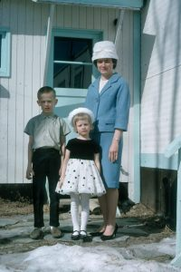 Photo courtesy of Clark Fair. Clark Fair, his little sister and mother all dressed up for a trip to town in 1968.