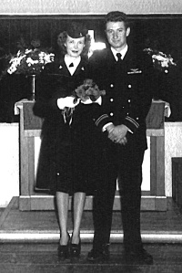 Photo courtesy of Michael Lee. Newlyweds Howard and Maxine Lee pose, in uniform, after their 1945 marriage in a chapel in Vero Beach, Florida.