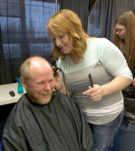 Photo by Jenny Neyman, Redoubt Reporter. Trista Cavallo cuts hair and boosts spirits at Project Homeless Connect held Thursday at the Soldotna Regional Sports Complex.
