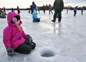 Photo by Joseph Robertia, Redoubt Reporter. Lacey Mathes, from Soldotna Elementary School, concentrates on catching a fish during an ice-fishing event on Sport Lake, which took place Feb 17 and18 as part of the Alaska Department of Fish and Game's Aquatic Education Program.