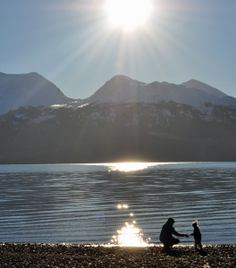 Photo courtesy of Joseph Robertia, Redoubt Reporter. A dad and daughter enjoy the view of the Kenai Mountains from the shore of Skilak Lake during a hike in the Kenai National Wildlife Refuge.