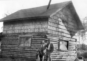 Photo courtesy of the KPC Historical Photo Archive. Howard and Maxine Lee pose with their children, Karen and Michael, next to their Soldotna homestead cabin in 1950.