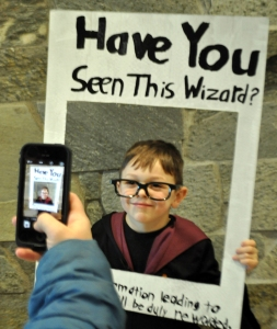 Photo by Joseph Robertia, Redoubt Reporter. Christian Edmunds, of Sterling, poses as Harry Potter while his mother, Donna, takes a photo. She said all three of her kids are Harry Potter fans.